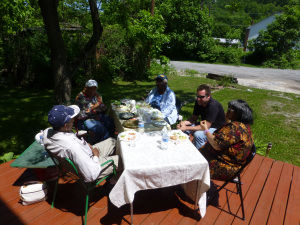 Folks gathered on the porch for food and conversation