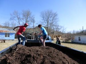 Shoveling the soil off.